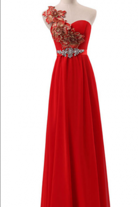 The red sleeveless ball gown with a formal evening gown